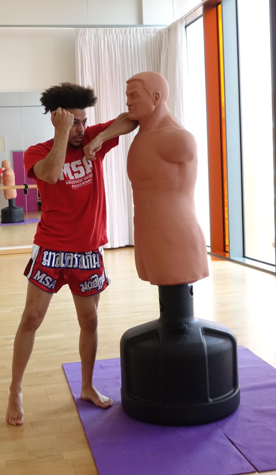 Cameron Practicing Muay Thai